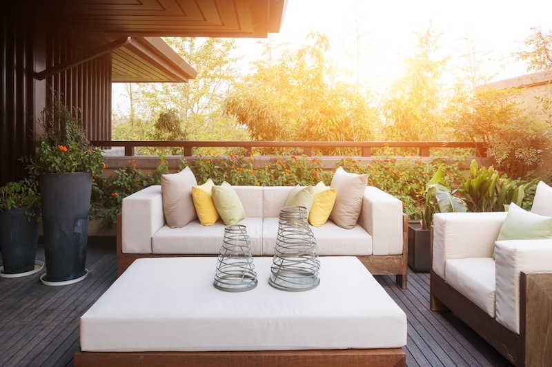 Porch with comfy outdoor furniture and plants