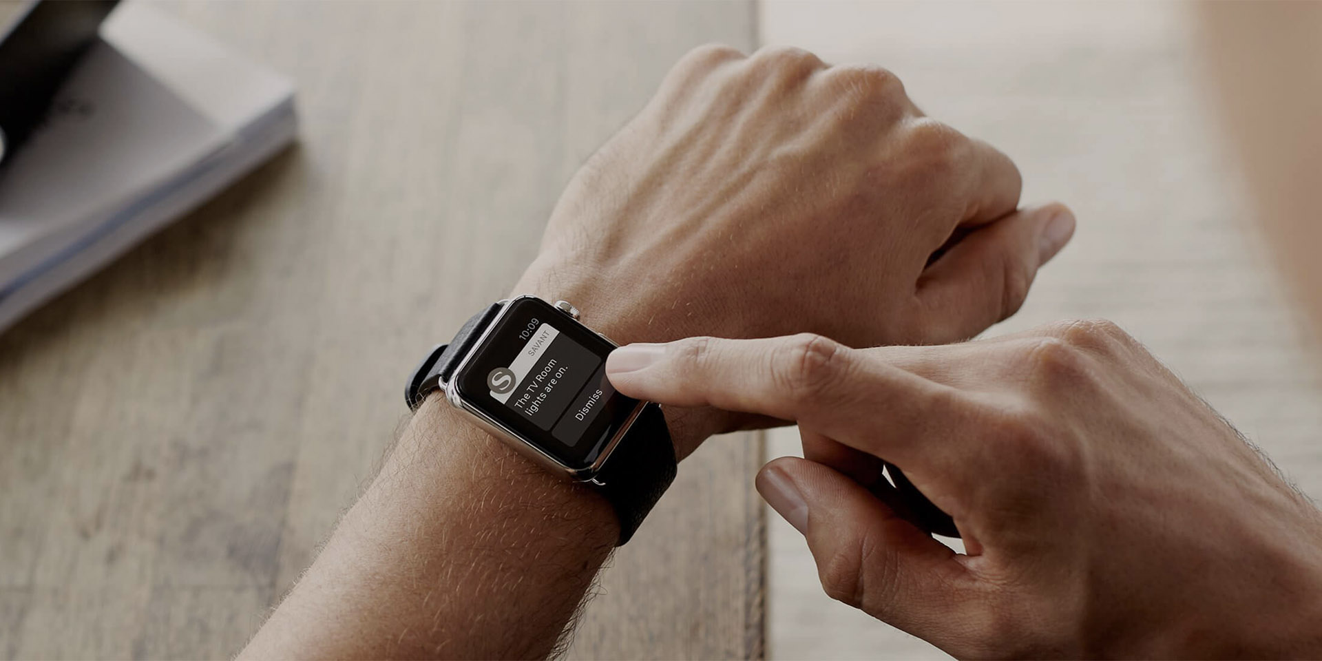A man looking at his Savant controls on Apple Watch